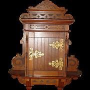 Oak spice cabinet with door & carvings & original porcelain labels
