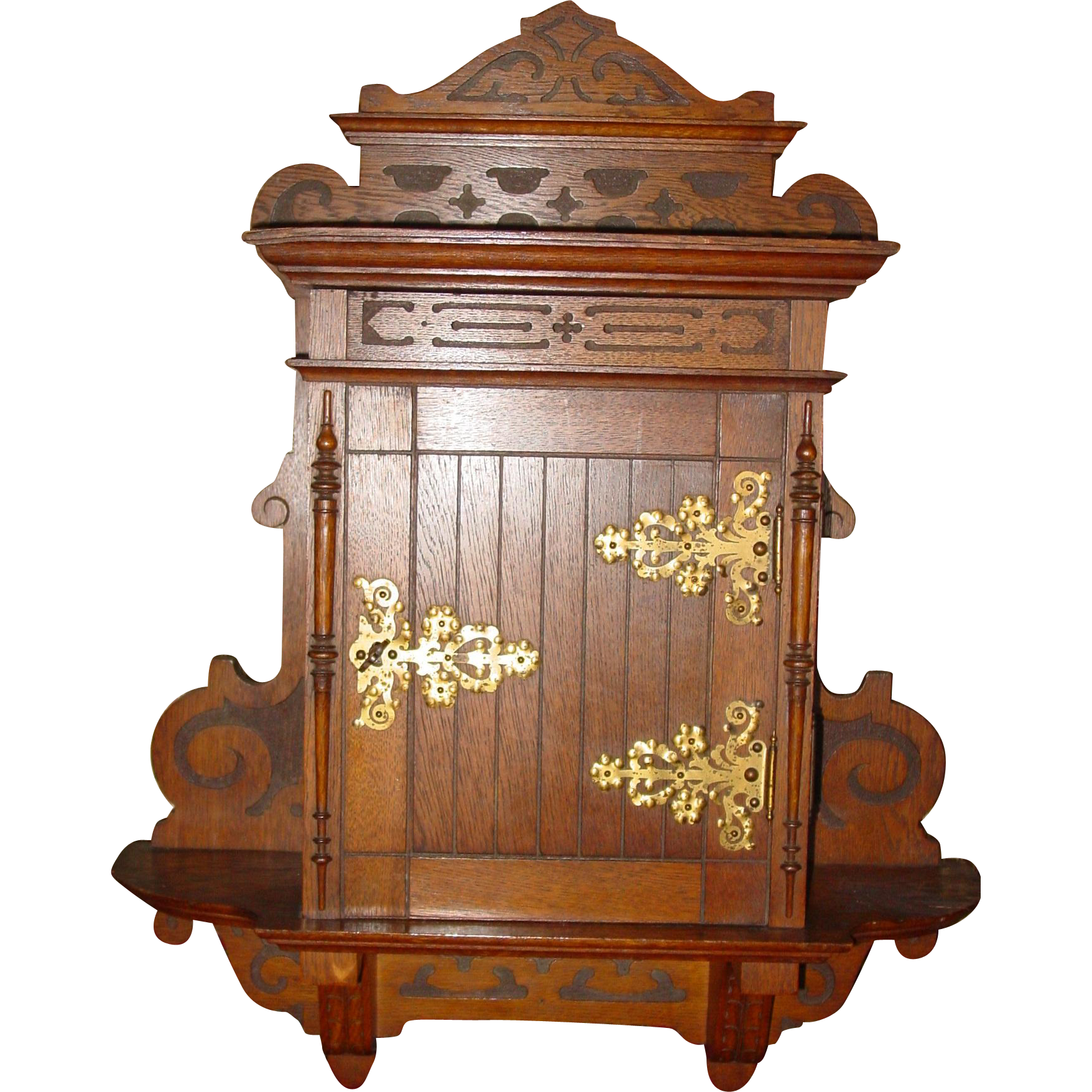 Oak spice cabinet with door & carvings & original porcelain labels