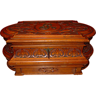 Ornately carved antique cherry wood jewelry box with hidden drawer