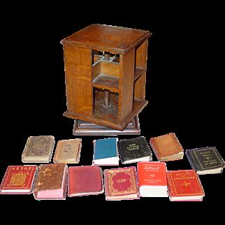 Unusual antique miniature salesman sample rotating oak bookcase with miniature books