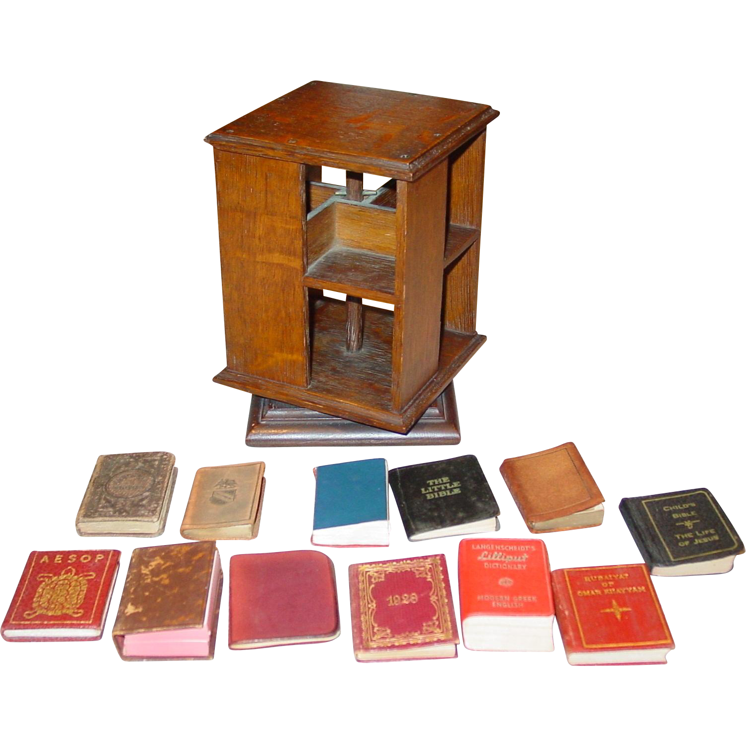 Unusual antique miniature salesman sample rotating oak bookcase with miniature books