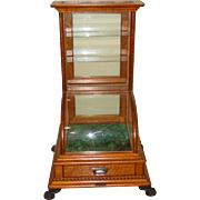 Excellent smaller size quartered oak curved glass display case