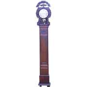 Fine antique tall case French clock with delicate carvings
