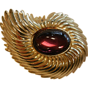 Vintage Gold-Tone Nautilus Costume Jewelry Brooch w/ Amethyst Glass Cabochon