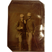 Old Tin Type Photograph Of Two Dapper Gentleman With Matching Hats and Walking Sticks Canes