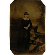 Small old Tin Type Photograph with A woman Sitting In A Chair with Necklace Locket