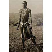 Vintage Original B&W Photo Postcard - Beautiful Young African Man Decorated with Beads and Feathers