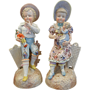 Antique Pair of Porcelain Figurines - Children Holding Dolls