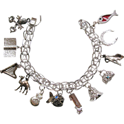 Vintage Sterling Silver Charm Bracelet With Twelve Charms