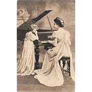 1912 Sepia postcard Mother Daughter Grand Piano