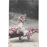 1909 RPPC Girl With Flower Cart Hand Colored Real Photo Postcard
