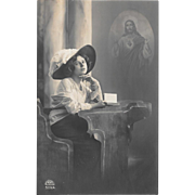 RPPC Woman With Rosary Under Image of Jesus Christ 1912 Real Photo Postcard
