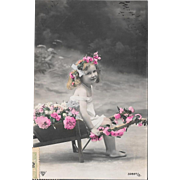RPPC Young Girl With Hand Colored Flowers