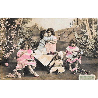 1907 RPPC Children's Picnic With Dolls