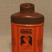 Vintage Miniature Cuticura Talcum Powder Tin Black on Orange