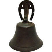Vintage wall mounted bronze dinner bell from the 1950-60s that is still in very good condition