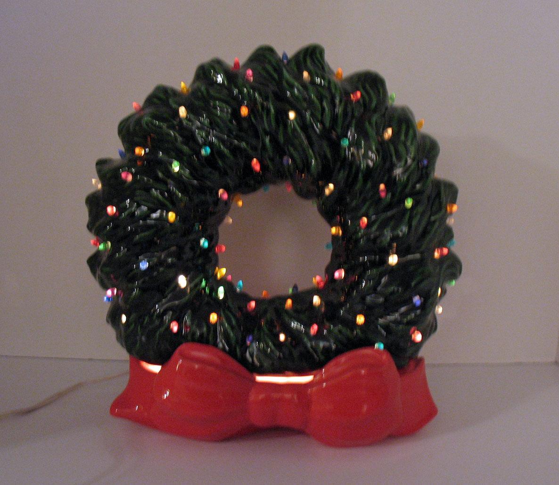 vintage ceramic christmas wreath with faux plastic lights lit up