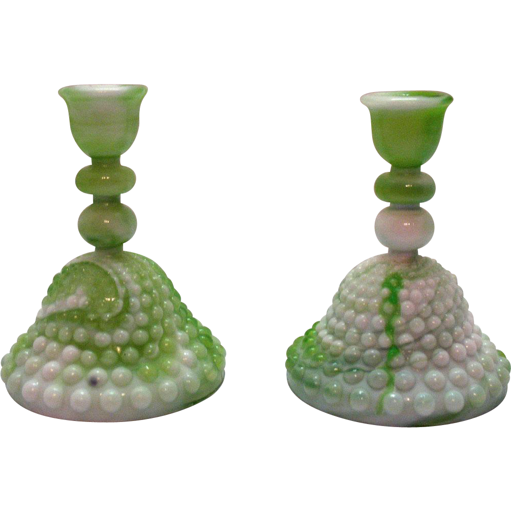 Vintage Akro Agate style of slag marble hobnail candle holders that are still in good condition.
