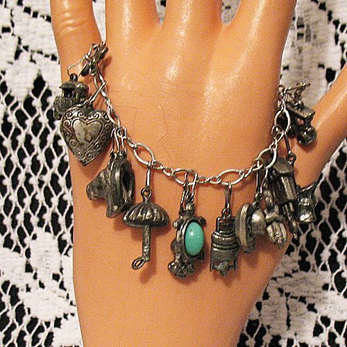 60% OFF Unique Vintage Sterling Silver Charm Bracelet 10 Pewter Double Sided Charms