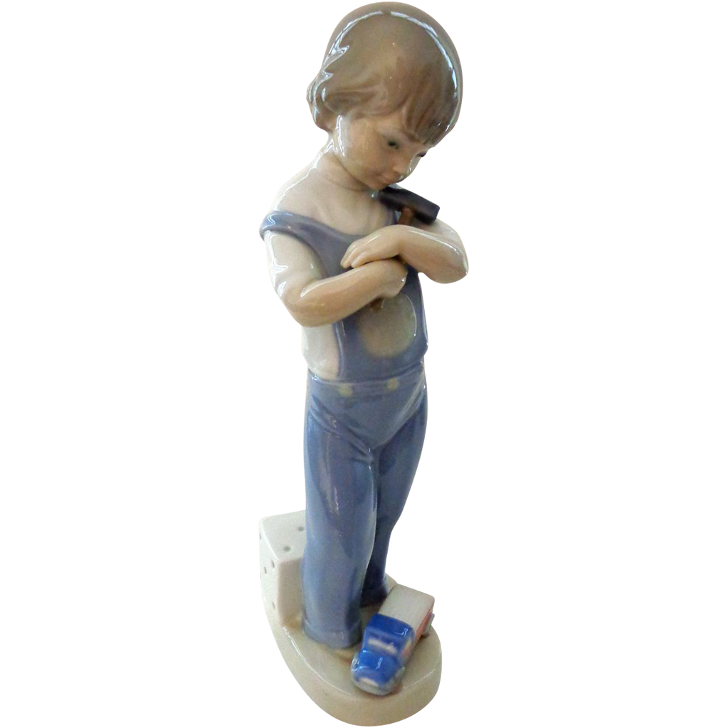Lladro Mechanic 4897 - Boy with Hammer, Truck, Die