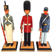 Group of 3 Carved Wooden Soldiers