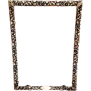 Sterling Silver Frame with Floral Details