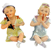 German Bisque Boy and Girl Figures