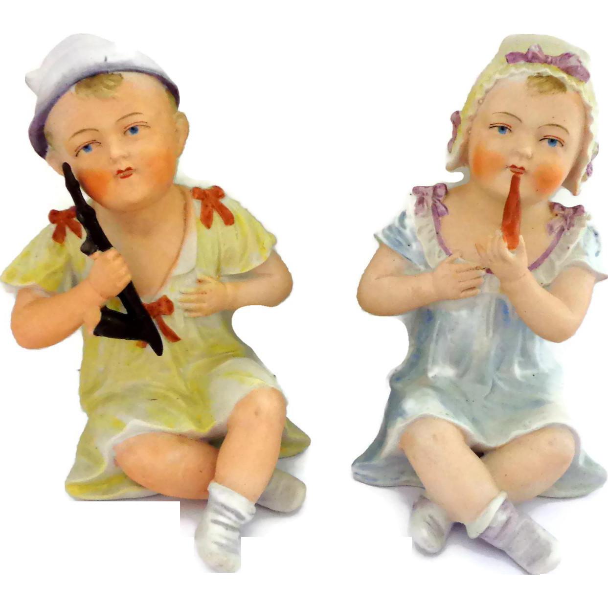 German Bisque Boy and Girl Figures