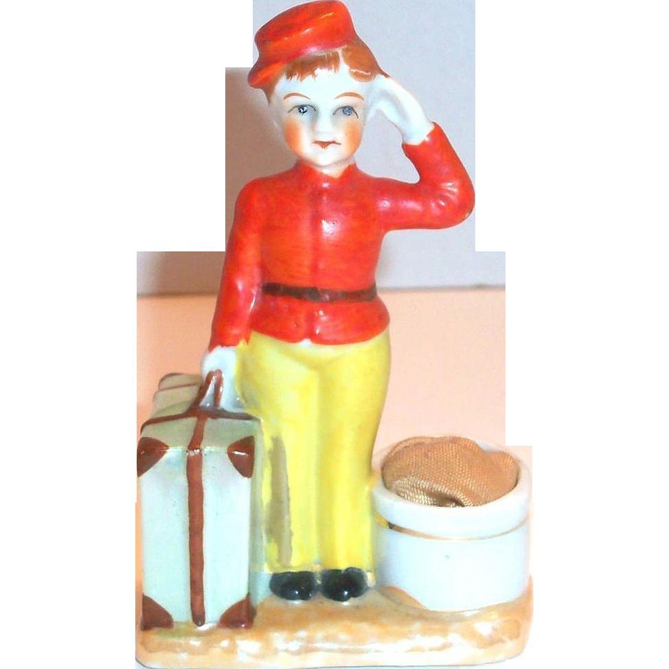 Darling Porcelain Bell Boy Pincushion Figurine