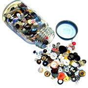 Mason Jar Filled With A Assortment of Vintage Buttons