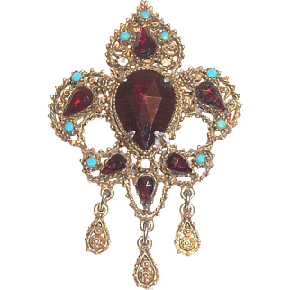 Lovely Gold Tone Fleur De Leis Pin With Ruby Red & Turquoise Colored Rhinestones