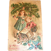 B.W.: A Merry Christmas Postcard (Children Decorating Tree)