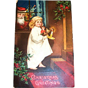 International Art Publ. Co.: Christmas Greetings Postcard (Santa Watching Thru Window At Girl With Candle)
