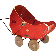 A Fibro Toy Small Doll Buggy