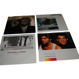 Set of Four 45 RPM Vinyl Records - Picture Sleeves