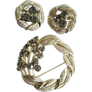 Goldtone and Smoke Colored Rhinestone Brooch and Earrings