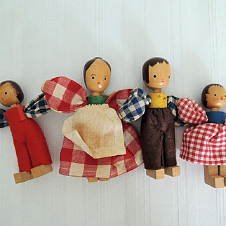 Family of Four Vintage Wooden Dolls