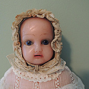 Sweet Wax Child with Blue Glass Eyes with Original Baby Clothes