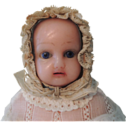 Wax Child with Blue Glass Eyes and Original Baby Clothes