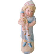 Lovely Early Figurine with Girl Holding Jester Doll