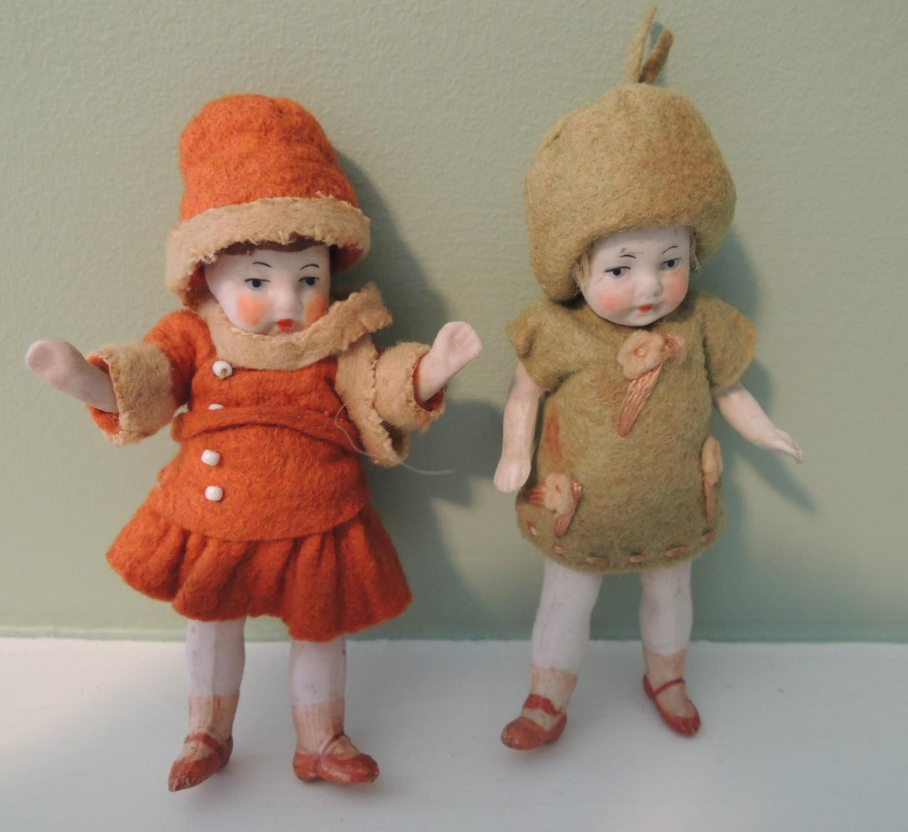 Sweet German All Bisque Pair of Little Girls In Original Outfits