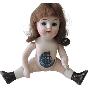 "Cute Four Inch All Bisque German Doll with ""Prize Baby"" Label"