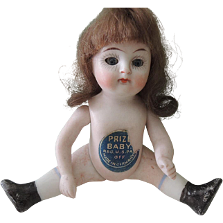 """Cute Four Inch All Bisque German Doll with """"Prize Baby"""" Label"""