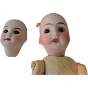 Two Bisque Doll Heads * One Small Paris SFBJ 301 Needing Body