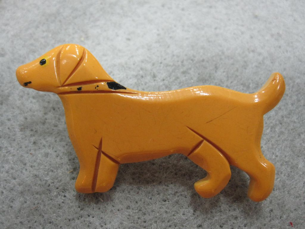 Carved Bakelite Butterscotch Dog Pin
