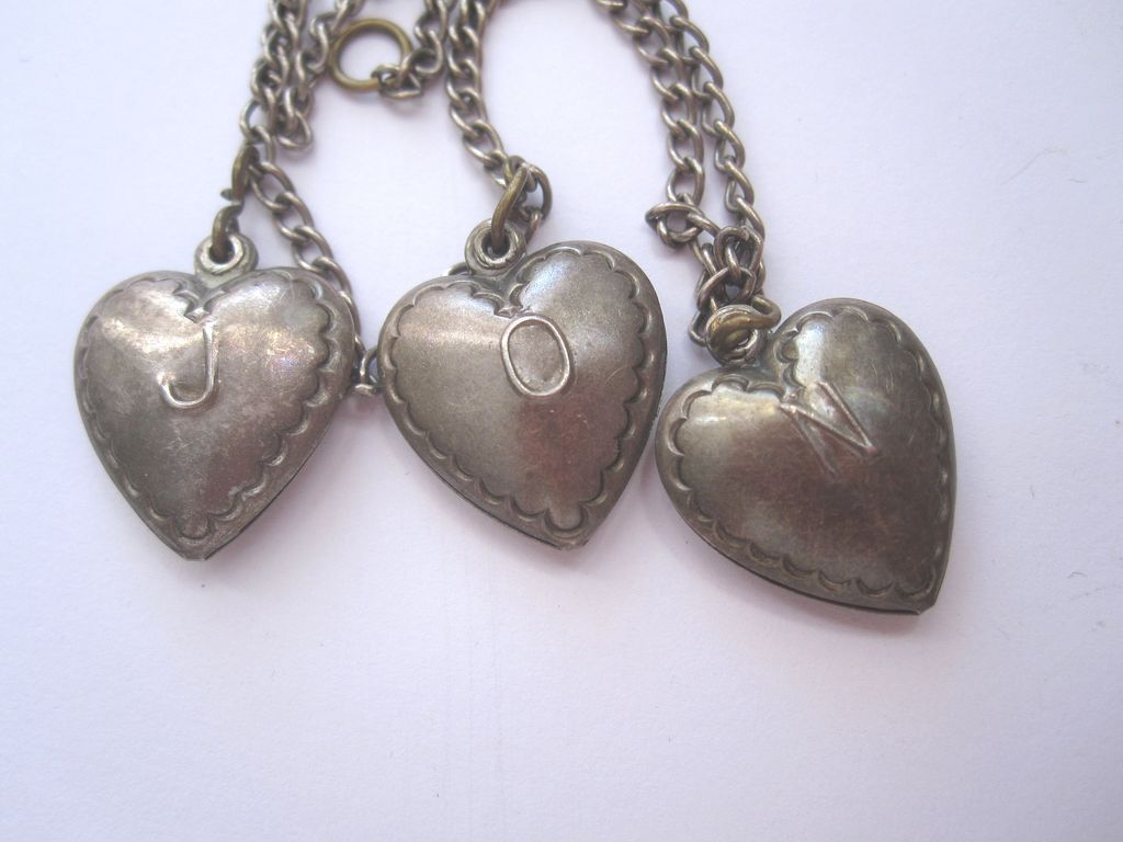 Antique Sterling Silver puffy heart charm bracelet