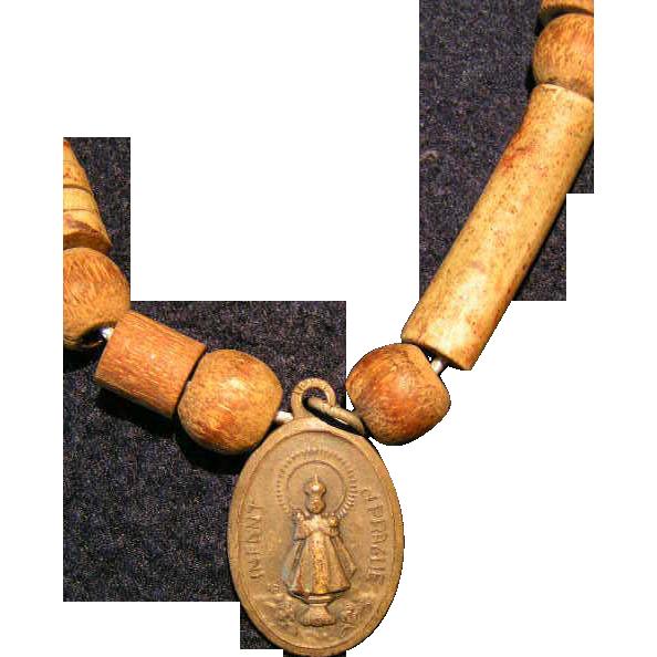 Infant of Prague medallion; vintage bronze