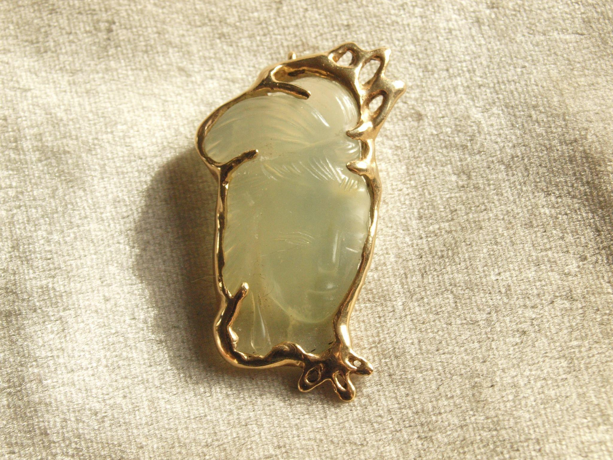 Carved Water Jade pendant in 14k frame