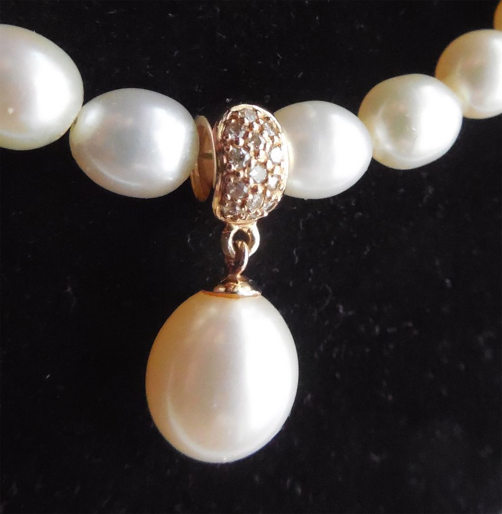 Beautiful Cultured Pearl Necklace With 14K Diamond Enhancer