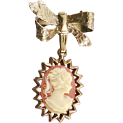 Vintage Cameo Pendant Dangling From A Bow Brooch